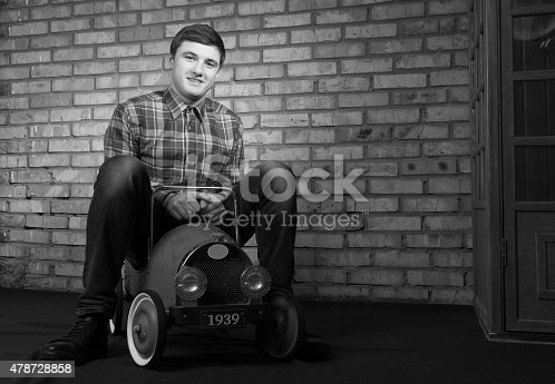 496487362istockphoto Happy Young Man Playing with Toy Car 478728858