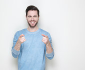 istock Happy young man pointing fingers 512750315