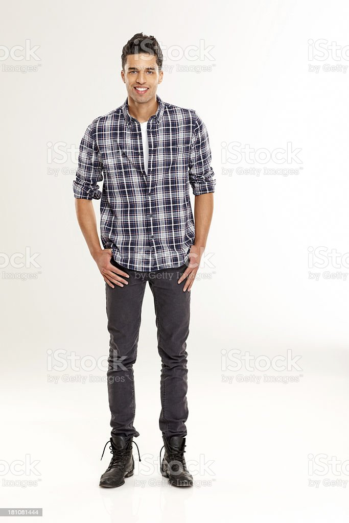 Happy young man posing over white background stock photo