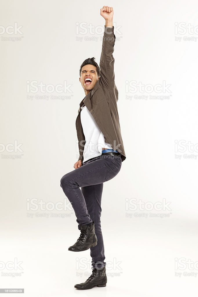 Happy young man rejoicing success over white stock photo