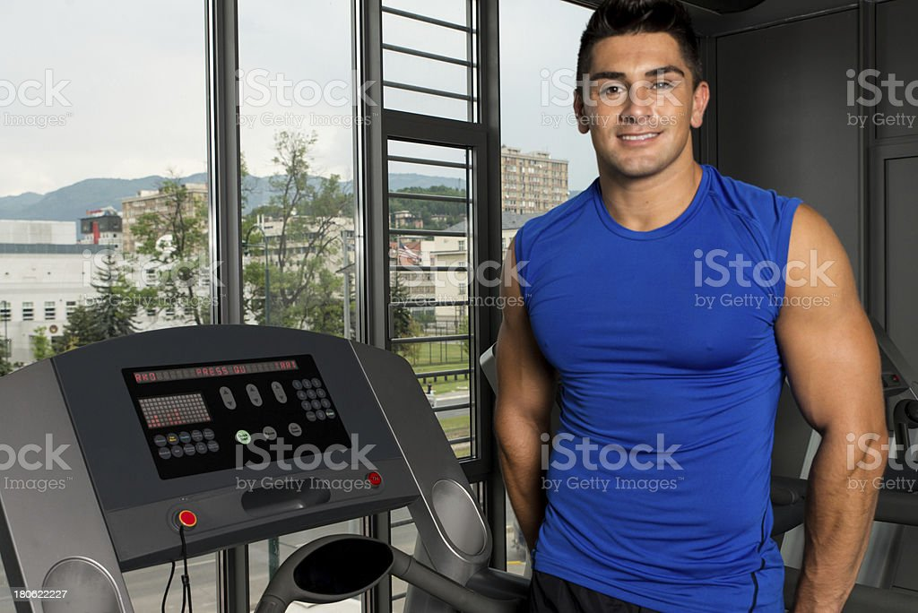 Happy young man resting after workout in the gym royalty-free stock photo