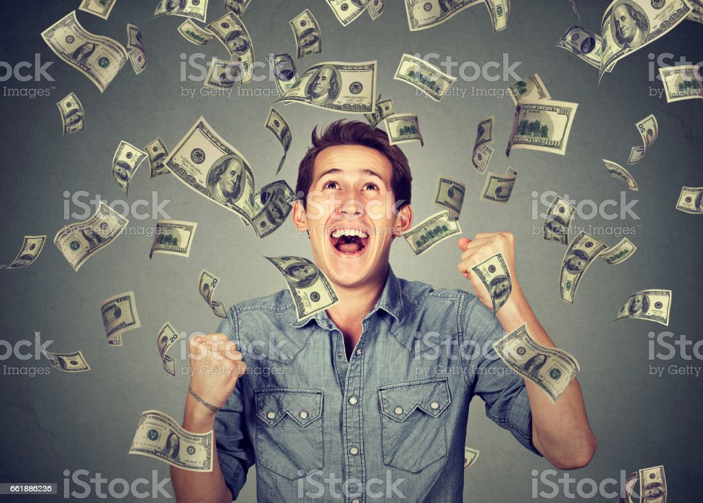 Happy young man screaming super excited stock photo