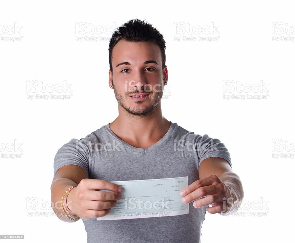 Happy young man showing check in his hands stock photo