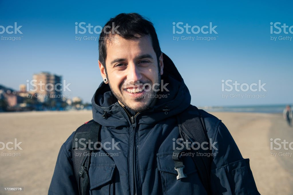 Happy young man smile on the beach royalty-free stock photo
