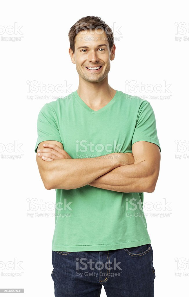 Happy Young Man Standing Arms Crossed stock photo