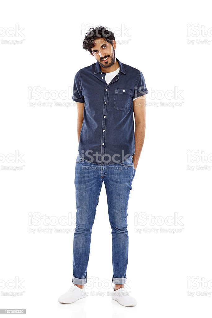 Happy young man standing relaxed on white royalty-free stock photo