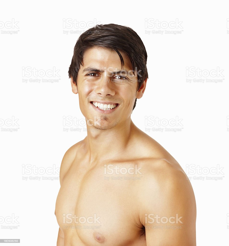 Happy young man standing shirtless on white background royalty-free stock photo