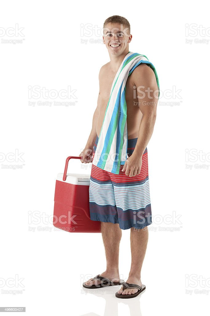 Happy young man standing with cooler stock photo