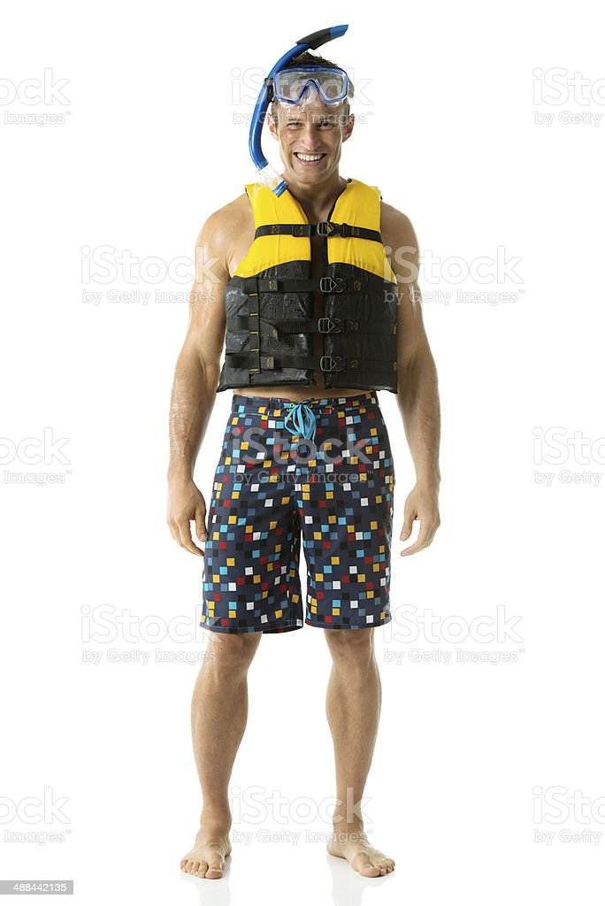 Happy young man standing with diving equipment stock photo