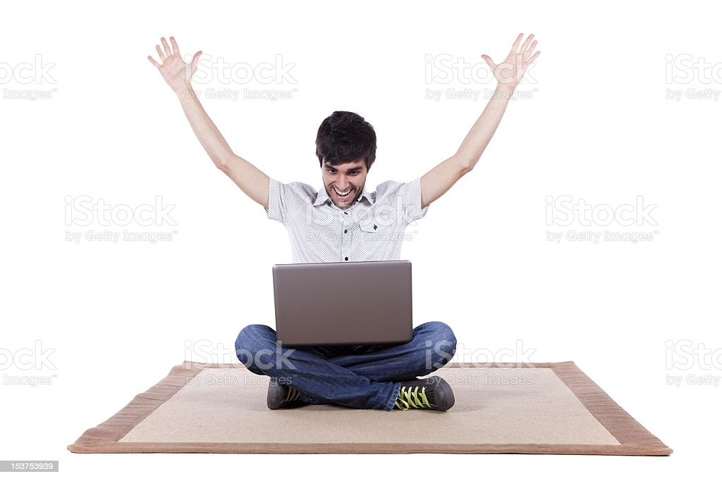 Happy young man surfing the internet royalty-free stock photo