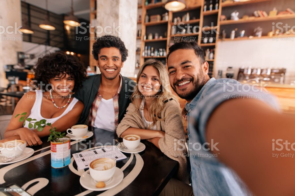 Happy Young Man Taking Selfie With Friends In A Cafe Stock Photo Download Image Now Istock