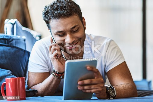 istock Happy young man talking on mobile phone 801859144