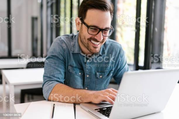 Happy young man using laptop closeup picture id1063913824?b=1&k=6&m=1063913824&s=612x612&h=9vpzpx1s9crnqlp6wa06ut9pygplff 2cjpgiyw3qyy=