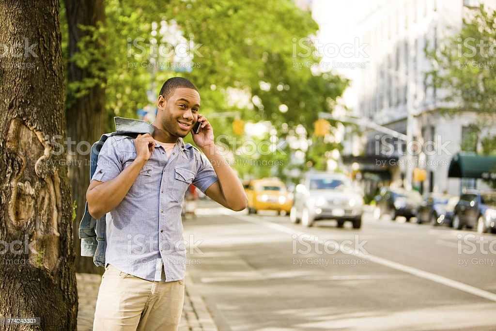 Happy Young Man Using Mobile phone outdoors royalty-free stock photo