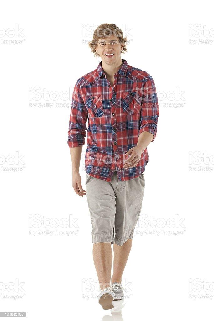 Happy young man walking stock photo