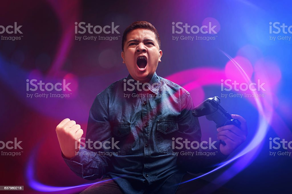 Happy young man winning the game stock photo