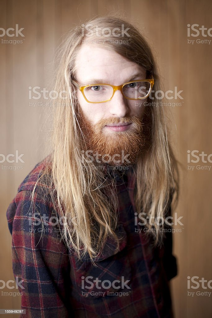 happy young man with a beard and long flowing hair stock photo