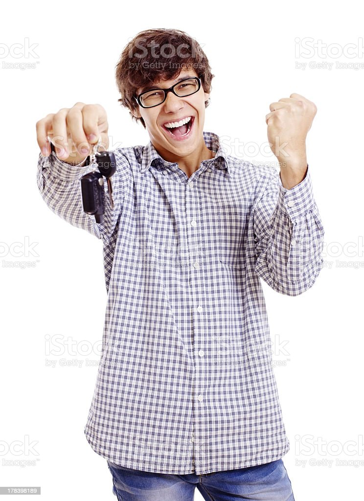 Happy young man with car keys stock photo