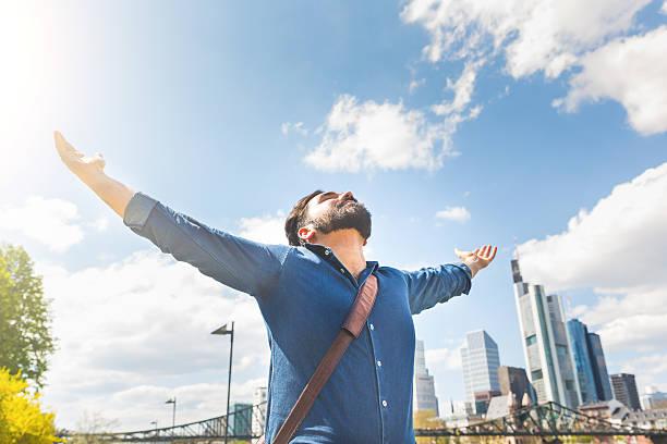 happy young man with frankfurt skyline on background - stadt frankfurt stock-fotos und bilder