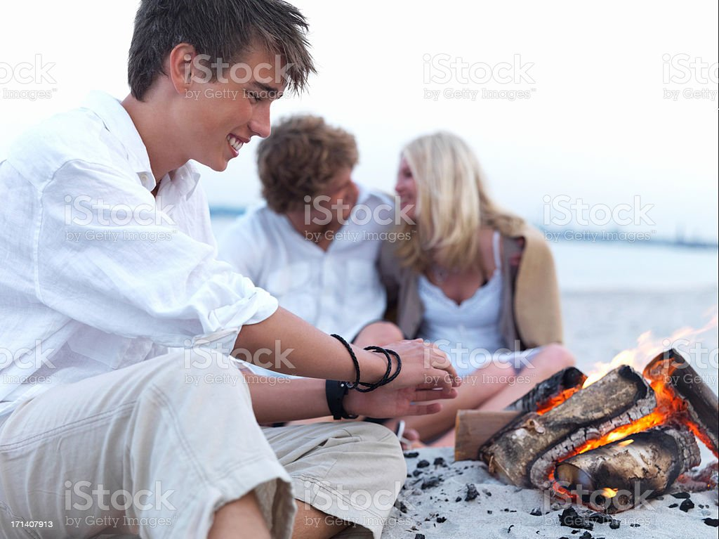 Happy young man with friends in the background royalty-free stock photo