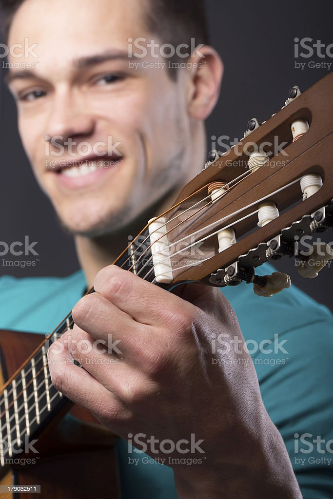 Happy Young Man With Guitar royalty-free stock photo