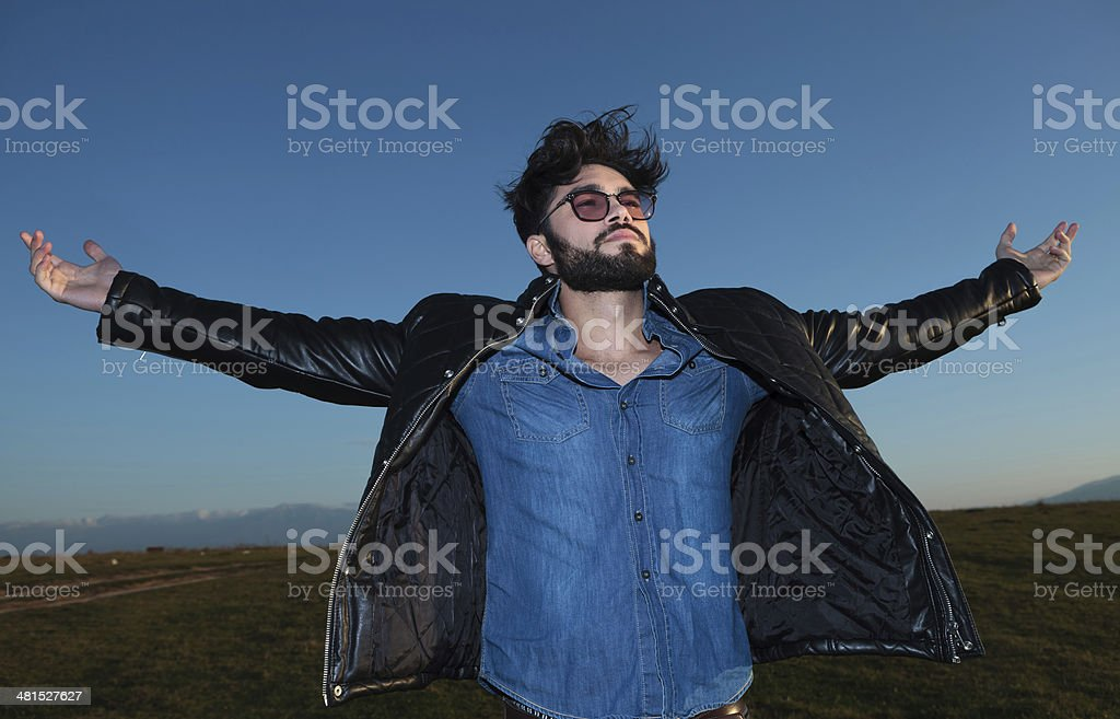 happy young man with outstrached hands stock photo