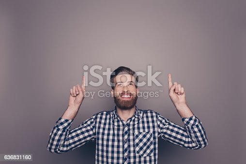 636829300 istock photo happy young man with toothy smile showing up with fingers 636831160