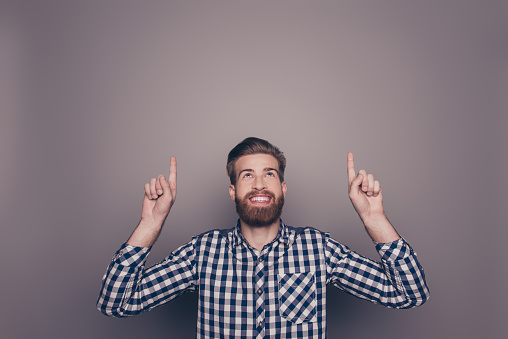 636829368 istock photo happy young man with toothy smile showing up with fingers 636831160