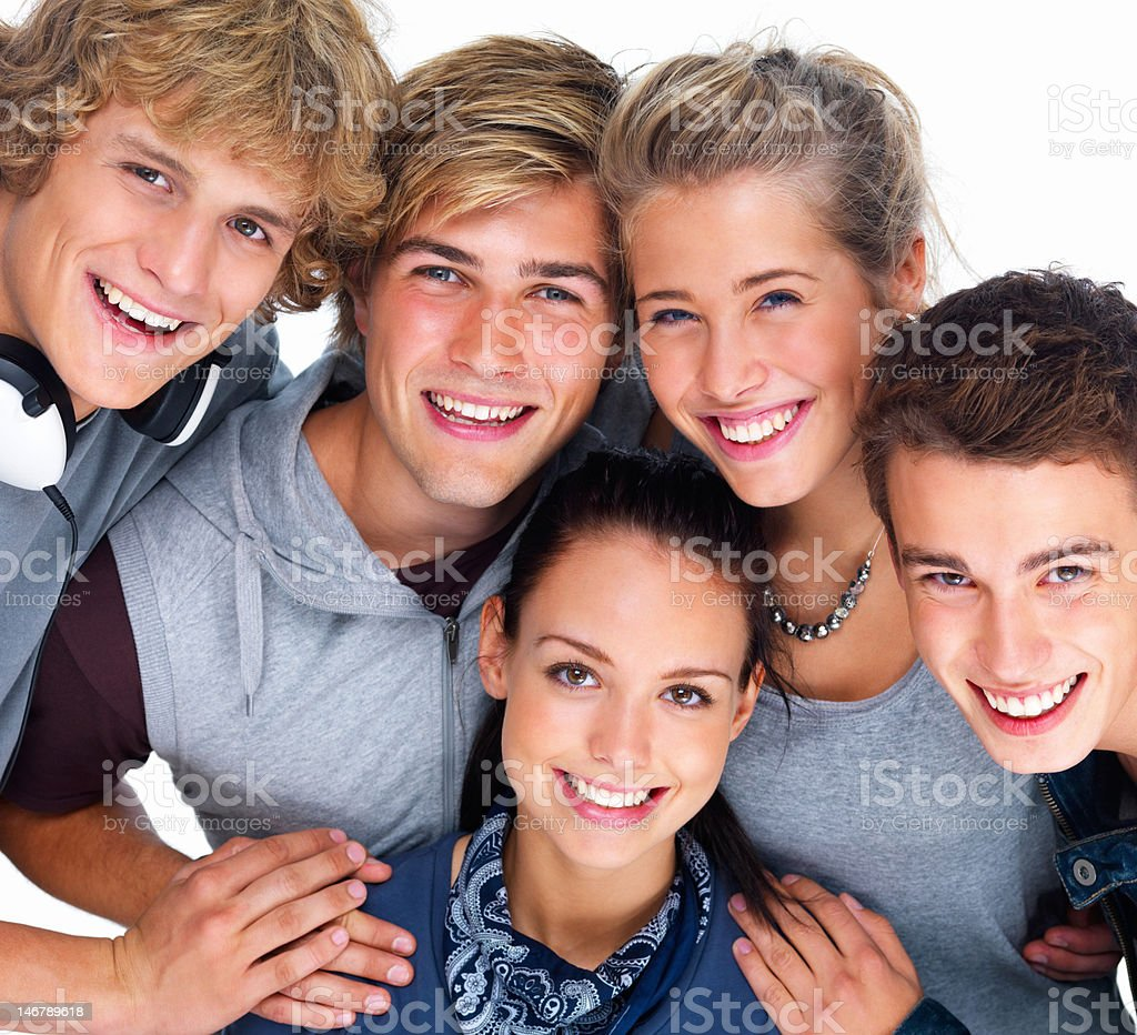 Happy young men and women posing stock photo
