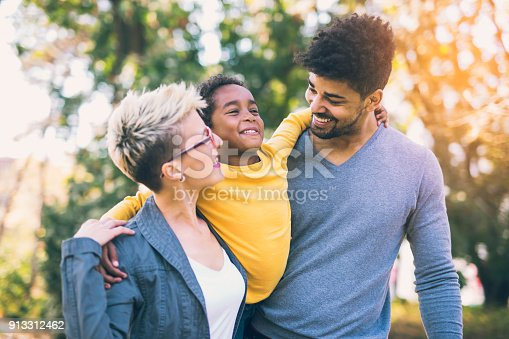 istock Happy young mixed race couple spending time with their daughter 913312462