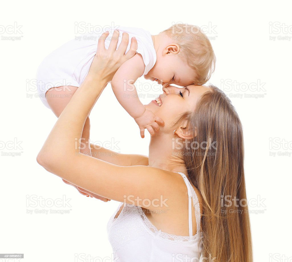 Happy young mother and baby having fun together stock photo