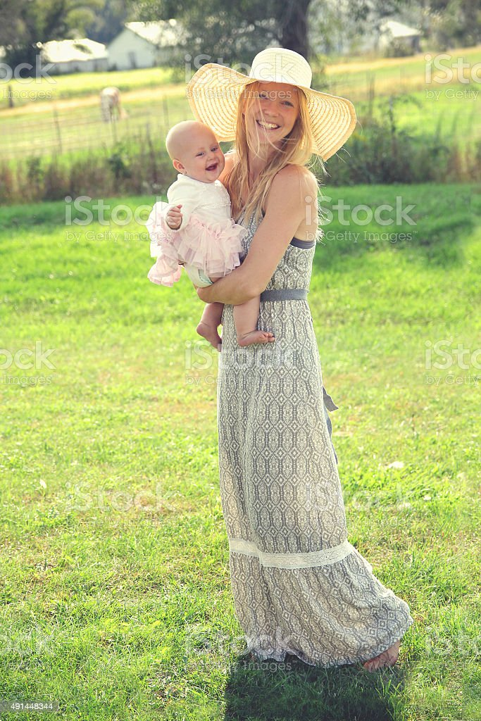 Happy Young Mother and Baby in Country stock photo