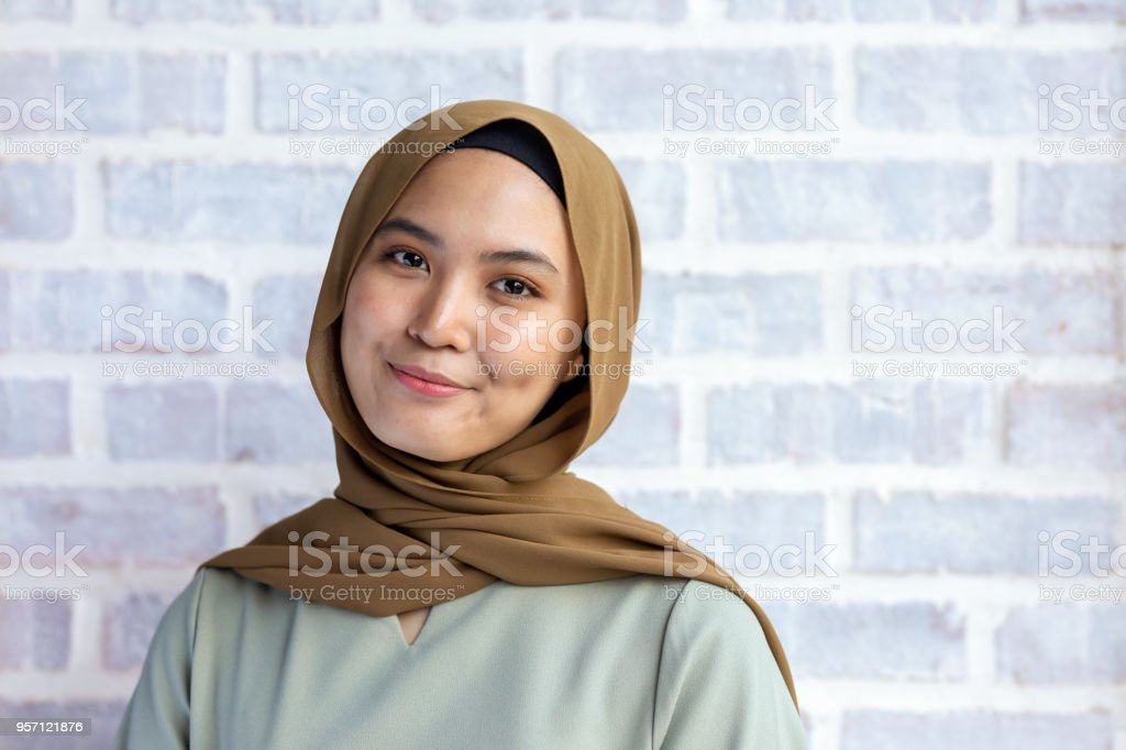 Happy Young Muslim Woman Smiling Wearing Hijab stock photo