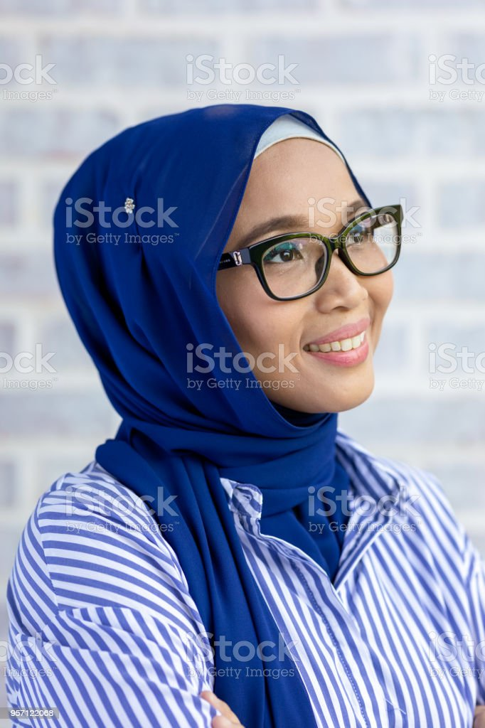 8b2a174bc22c Happy Young Muslim Woman Smiling Wearing Hijab Stock Photo & More ...