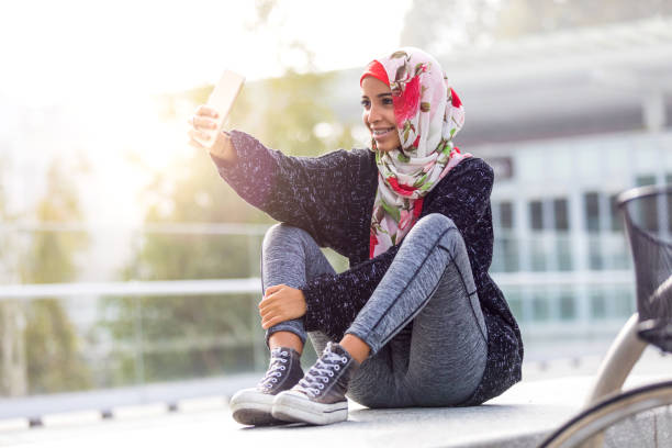 happy young muslim women - arabic girl stock photos and pictures