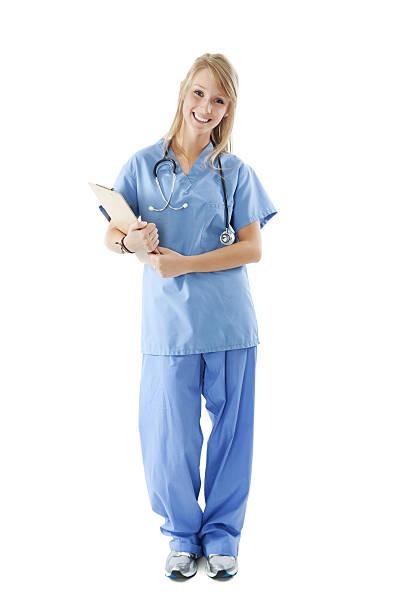 happy young nurse with clipboard, full body, isolated on white - hospital studio bildbanksfoton och bilder