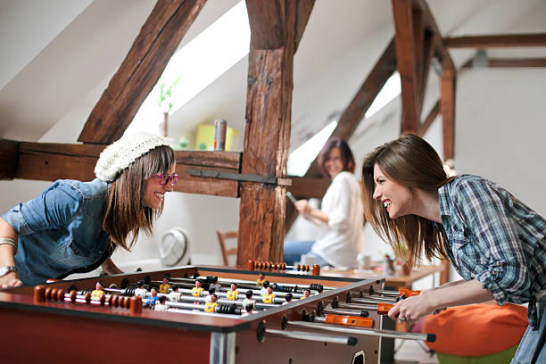 Royalty Free Happy Young Women Playing Table Football Pictures ... b2f47587f7