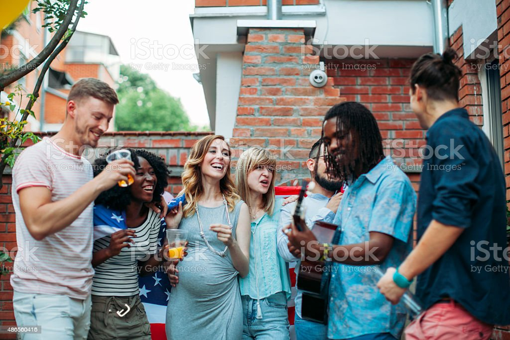 Happy Young People At Patio Party. stock photo