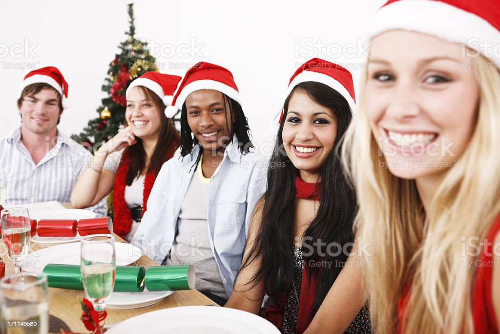 Happy young people, friends or colleagues, at Christmas dinner royalty-free stock photo