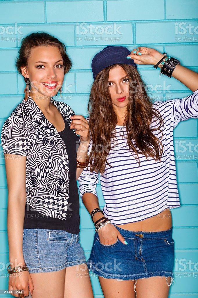 happy young people having fun in front of blue wall stok fotoğrafı