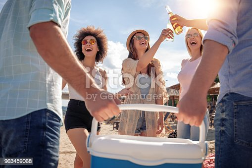 istock Happy young people having party on the beach. 963459068
