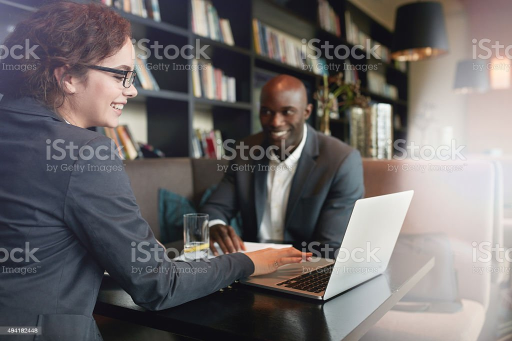 Happy young people in a business meeting at restaurant stock photo