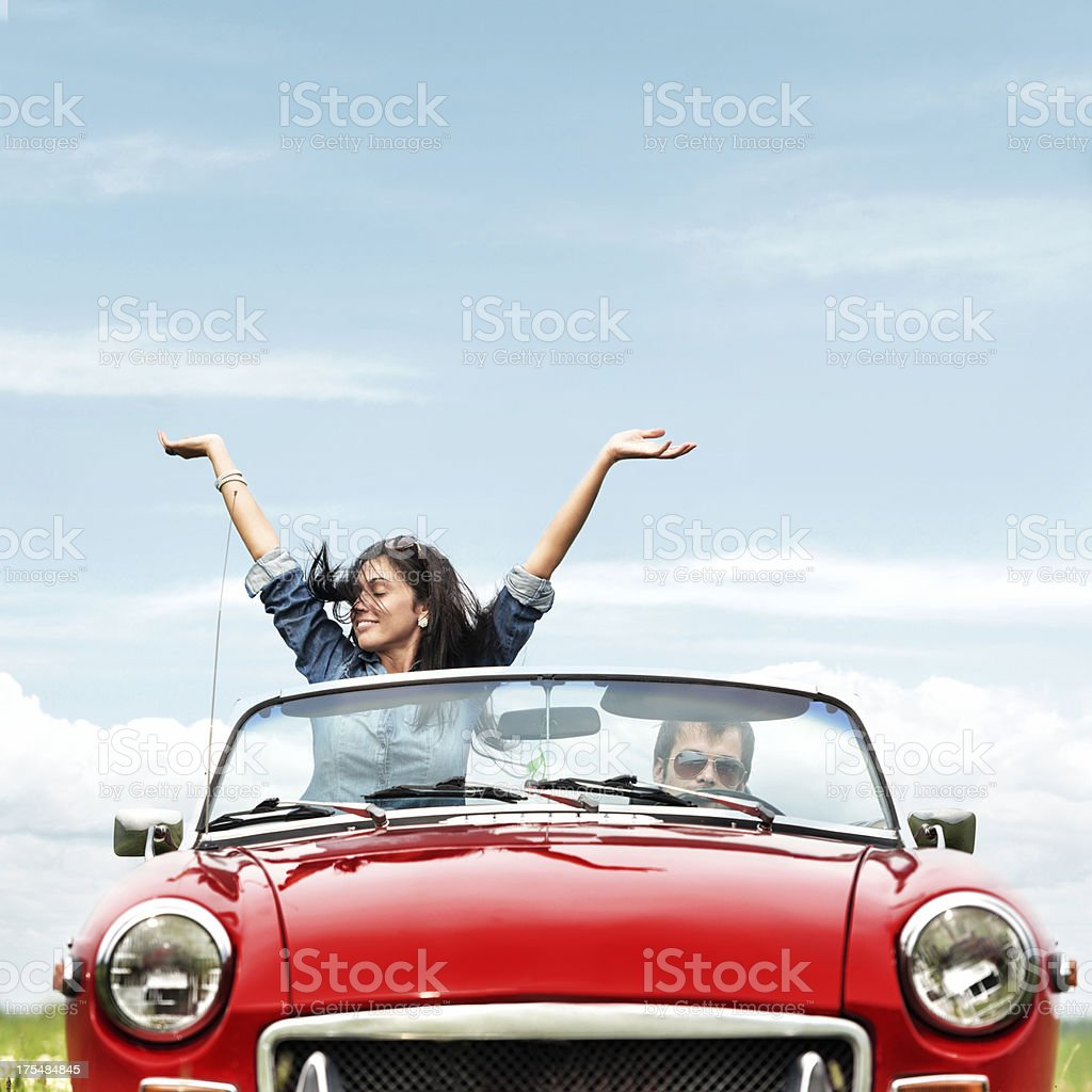 Happy young people in a cabriolet stock photo