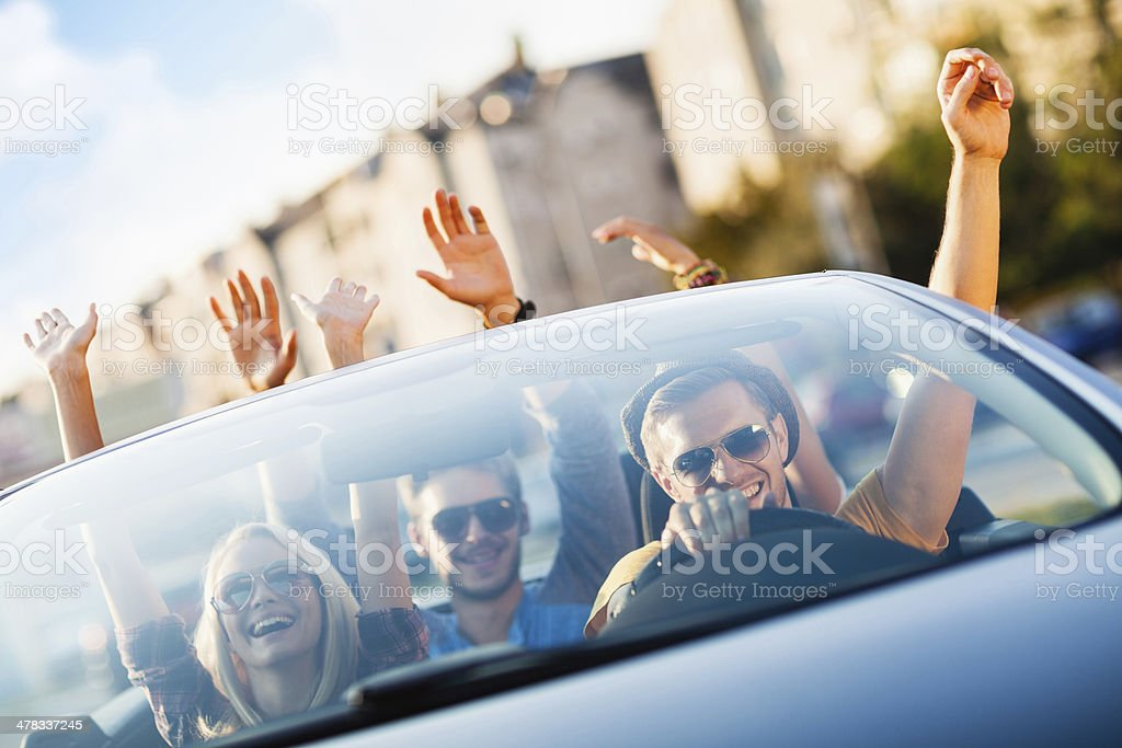 Happy young people in convertible car royalty-free stock photo