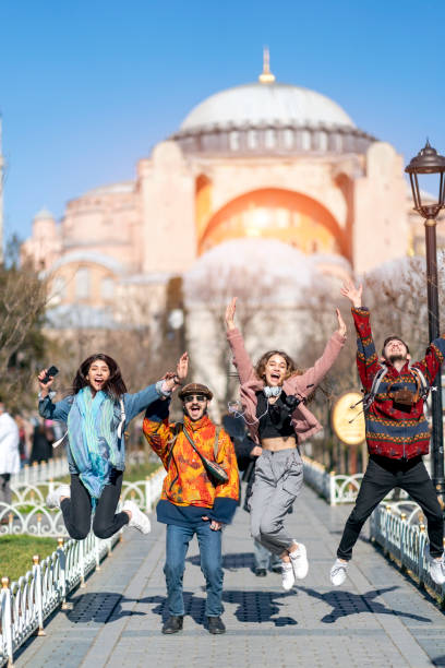 Happy young people jumping in front of hagia sophia in Istanbul stock photo