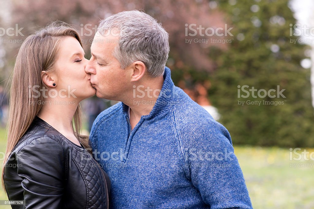 Happy young people kissing stock photo