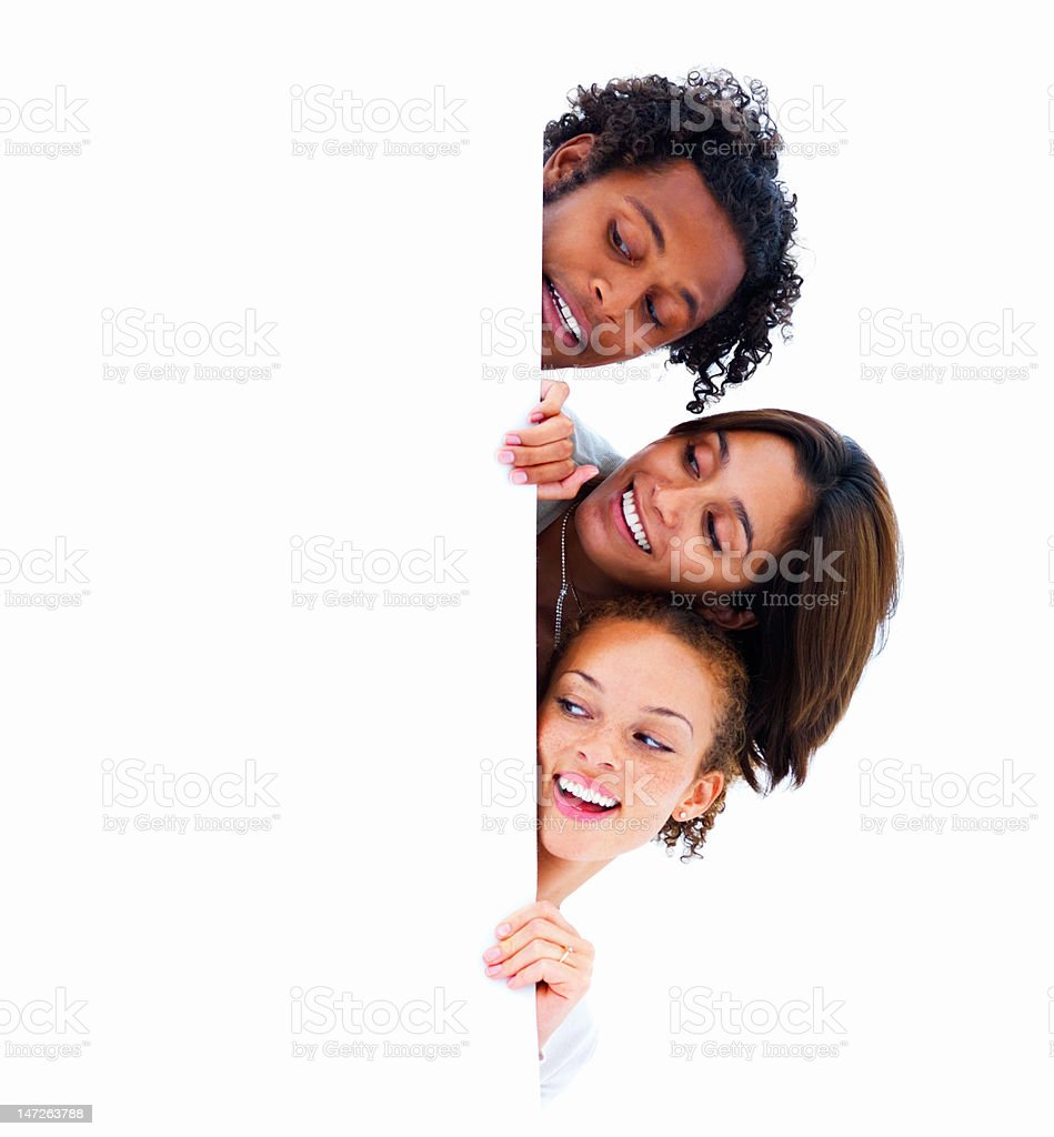 Happy young people looking on white board royalty-free stock photo