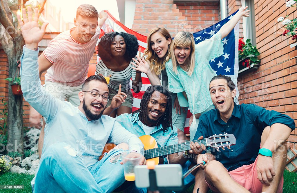 Happy Young People Making Selfie In A Backyard. stock photo