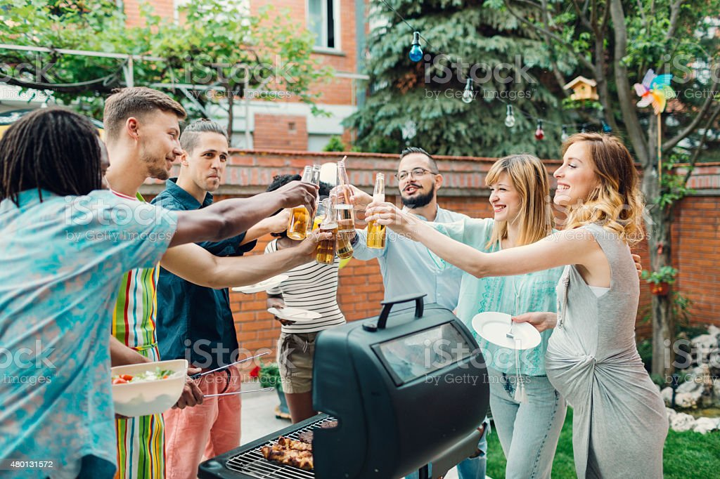 Happy Young People Toasting At Barbecue Party. stock photo