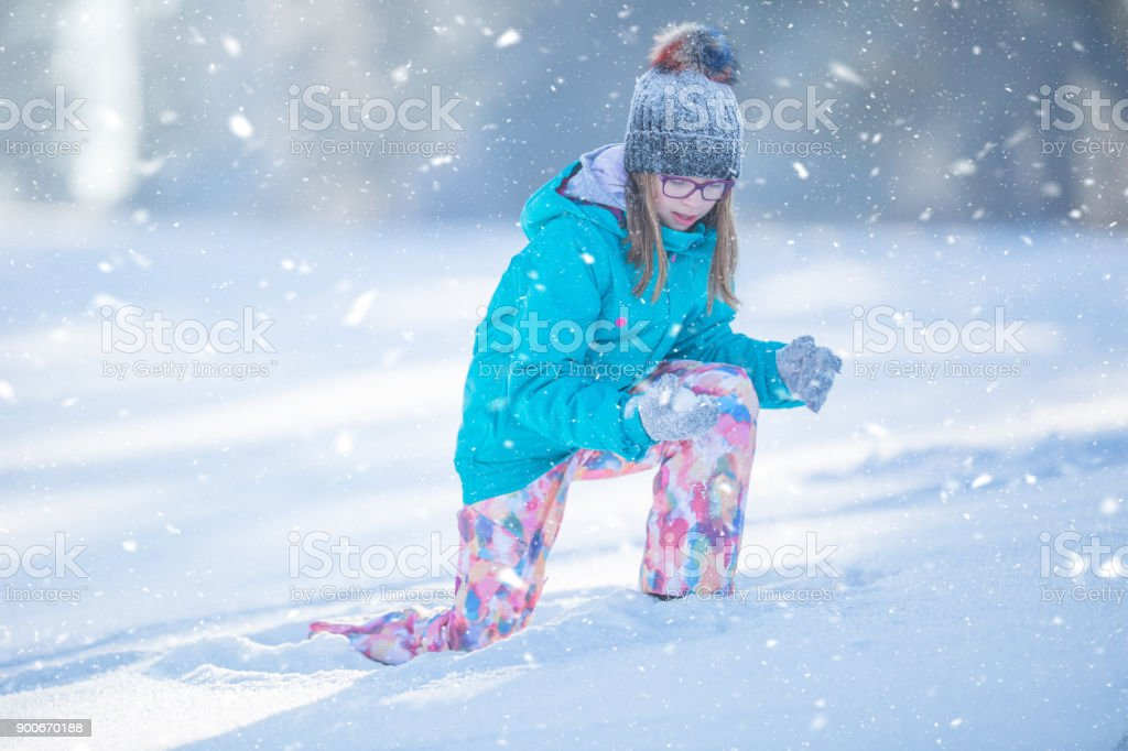 7bdc2e3b290e Happy Young Preteen Girl In Warm Clothing Playing With Snow Stock ...